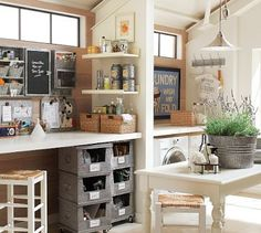 This is my dream space.....laundry room meets hobby space.