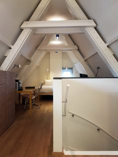 Giving your attic room a new purpose can increase your home's living space while adding more to it's value! Check out some of these attic room conversion ideas for inspo. #AtticRoom #AtticConversion #HomeRenovationIdeas