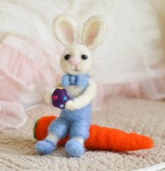 Needle Felted Barney Bunny Holding Easter Egg and Sitting On Carrot by Cynthia Foust Wolfe on Etsy, $35.00