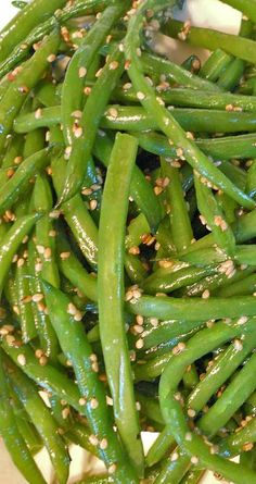 Recipe for Sesame Green Beans - A quick and easy side dish recipe. A perfect compliment to any holiday spread. A quick and easy side dish recipe. These Sesame Green Beans are a perfect compliment to any holiday spread. Side Dishes For Chicken, Side Dishes Easy, Vegetable Side Dishes, Side Dish Recipes, Vegetable Recipes, Recipes Dinner, Chicken Recipes, Yummy Recipes, Salad Recipes