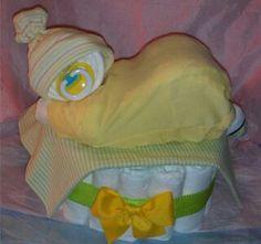 Sleeping baby diaper cake.