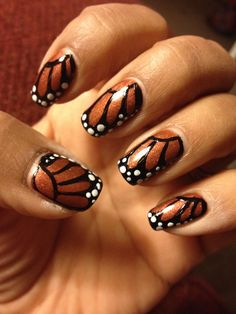 Monarch butterfly inspired nail art.