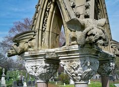 "The John Matthews monument at The Green-wood Cemetery, specifically two of its four gargoyle waterspouts. The Green-Wood Historic Fund is currently raising funds to restore this monument, which used to be grander and even larger, as part of its Saved in Time program. John Matthews is credited with the development of a device to carbonate soft drinks and was known as the ""Soda Fountain King."""