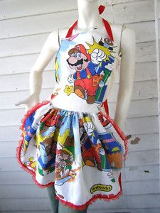 Mario Bros Apron - Retro Ruffle - Vintage Fabric from PoppysGardenGate on Artfire. Saved to Cool Stuff. Funny Aprons, Cute Aprons, Aprons For Sale, Cobbler Aprons, Ruffle Apron, Childrens Aprons, Dress For Success, Super Mario Bros, Clothes For Women