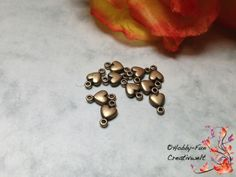"""10 Zwischenspacer bronzefarben """"Herzchen"""" für viele kreative Schmuckideen geeignet. Wunderschön gearbeitet, einfach zum Verlieben."""