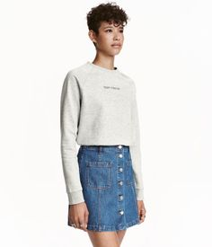 Gray. Soft sweatshirt with a motif at front and ribbing at neckline, cuffs, and hem. Soft, brushed inside.