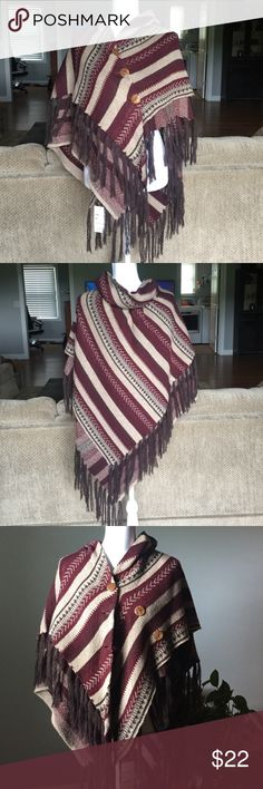 Poncho with Fringe Poncho with Fringe at bottom. 3 buttons on side. NWT. One Size but would fit a medium or large. Colors are burgundy, cream, brown . Jackets & Coats Capes
