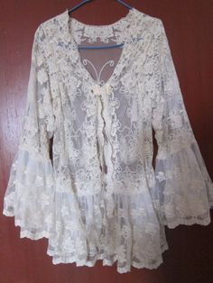 RESERVED..vintage inspired soft cotton jacket with ruffles of lace. and butterfly details....: