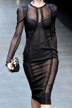 sheer sleek gorgeousness - with a fitted black dress underneath.