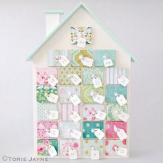Advent house covered with scraps of wallpaper/scrapbook paper/fabric. Advent Calendar House, Advent House, Noel Christmas, Christmas Crafts, Christmas Decorations, Holiday Decor, Xmas, White Christmas, Christmas Ideas