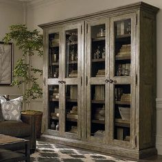 Compass Tall Double Display Cabinet by Bassett Furniture. Create your own private retreat with this wall system offering timeless home storage solutions.
