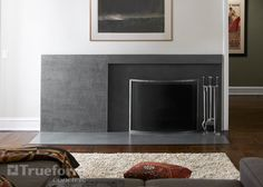 Concrete foundation wall panel and hearth a wood burning fireplace. Concrete Fireplace Surrounds -Trueform Concrete Custom Work
