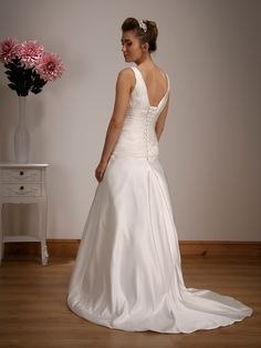 1517 - A classic gown in stunning satin with a flattering V shape neckline and back, finished with a satin sash and bow.