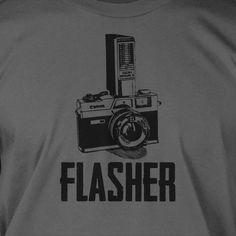 Gifts for Photographers Flasher Retro Camera Photography Tshirt T-Shirt Tee Shirt Mens Womens Ladies Youth Kids. $14.99, via Etsy.