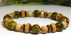 About the Bracelet Earthy boho chic beaded bracelet with natural picture jasper and salwag seeds. Perfect for the nature girl at heart. Bracelet Details: This beautiful gemstone bracelet is made with: