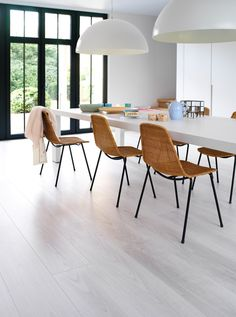 BerryAlloc® makes you feel at home. Laminate, parquet, vinyl planks & tiles: our extensive collections have a flooring solution that is just right for you. Walnut Laminate Flooring, Dining Chairs, Dining Table, Dining Room, Scandinavian Interior Design, Contemporary, The Originals, Elegant, Furniture