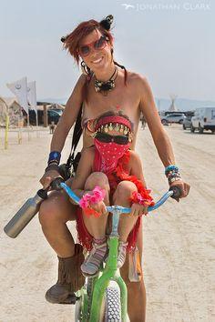 burning-man-2013-cargo-cult-black-rock-city-jonathan-clark-mother-and-daughter-on-bike