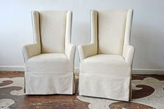 Our client's head dining chairs were badly chewed by her beloved dog! Now they have new slipcovers! The textile is Stroheim's Clansey Metallic with contrast cording in Maxwell Fabrics's Juneau in Mineral.