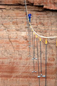 Nik Wallenda walks across Grand Canyon on 2-inch wire (Photo: Tiffany Brown / AP Images for Discovery Communications)