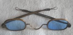 "Gambler ""Cheater"" Glasses  Pre Civil War period brass spectacles with blue lenses. The stems telescope in and out. This shade of glasses were used by gamblers to cheat with. They would mark cards with a luminous product that was only visible when viewed through blue tinted glasses. One lens is a little loose but will not fall out of frame."