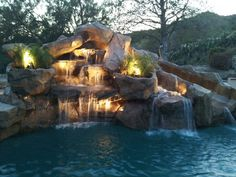 slides with stone waterfall for inground pools | Rock waterfalls with slide added to swimming pool. | Yelp