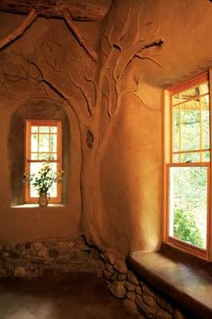 Could be a room in Rivendell.  - Earthen accent makes dramatic statement, tree designed by Deanne Bednar.