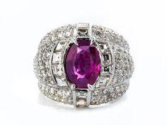 Ringweite: 51. Gewicht: ca. 11,4 g. WG 750. Prächtiger hochwertiger Ring mit einem feinen transparenten pinken Saphir im ovalen Facettenschliff, ca. 2,3 ct,...
