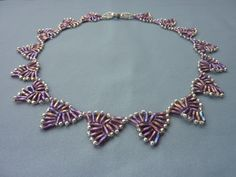 FREE beading pattern for necklace woven with bugle beads and 10/0 seed beads into a string of triangles making a lovely geometric design.