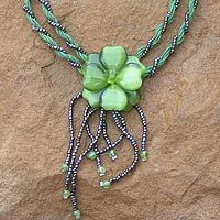 Stainless steel, peridot, glass, cotton cords  Lobster claw clasp