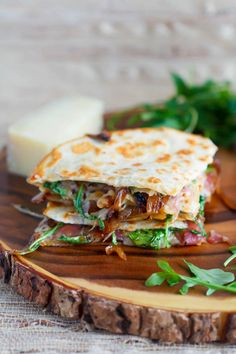 Whoa, this Caramelized Onion, Prosciutto and Fig quesadilla recipe is a fancy twist on our kids' favorite dinner.