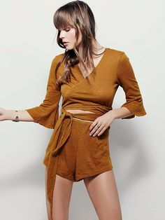 Bolina Romper | Made from our semi-sheer Beach slub, this lightweight romper features a surplice neckline with adjustable waist ties and elastic insert for an effortless fit. Exposed midriff detailing and subtle bell sleeve accents.