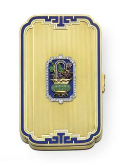 AN ART DECO ENAMEL, MULTI-GEM AND GOLD VANITY CASE, BY CARTIER   The textured 18k gold rectangular case, trimmed with blue and white enamel, centering upon a gold, black enamel and carved emerald vase with green, purple and maroon enamel flowers and a blue enamel faucet, against a blue enamel background, trimmed by rose-cut diamonds, the buff top sapphire pushpiece, opening to reveal a fitted mirror and a compartment, circa 1925, 2¾ x 1¾ x 3/8 ins.  Signed Cartier