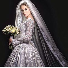 This dynamic long sleeve wedding gown is ornate yet still quite classy. The embroidery embellishment detail is what makes this #fashion piece incredible. Designer #weddingdresses like this do not have to cost a fortune.  Our design firm is based in the USA and can offer totally custom wedding gowns like this to brides for a very reasonable cost.  Replicas of haute couture bridal gowns are also an option.  So if your dream dress is more than you can afford email us the picture to see how much…