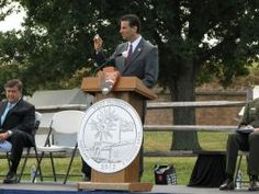 Representative John Sarbanes holds a Fort McHenry quarter at the launch ceremony for the Fort McHenry Quarters
