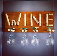 "Wine Cork / Crafts / Wine Glass Holder / DIY / Wood / WINE / Home Decor ~ Cut a piece of scrap wood and stain it any color. Screw the wine corks onto the wood from the back (enough distance apart to hang your stemware) then glue the word ""wine"" above it with the extra corks! ~"