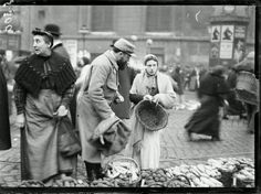 Women in France filled all sorts of men's jobs during WWI.  Selling farm products in Les Halles open air food market, Paris, 1916.
