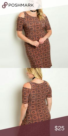Plus size rust colored dress Rust and navy colored printed dress, cold shoulder style, polyester spandex material. Dresses Midi