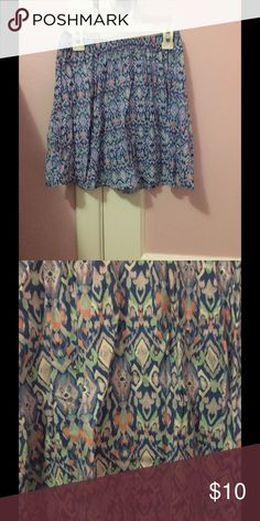 Multicolor skater skirt Skater skirt with blue, mint, and pink coloring and a super cute design. Fits flowy and stretchy around waist. Worn multiple times Hollister Skirts Circle & Skater