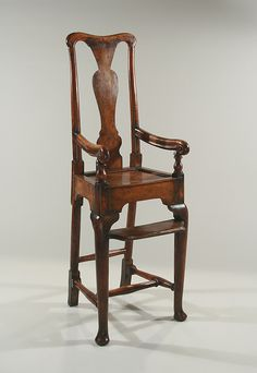 """GEORGE II YEWWOOD & FRUITWOOD CHILD'S HIGHCHAIR - England, c1730, The concave crestrail over a vase-shaped splat & a solid seat, raised on front cabriole legs ending in  pad feet having a solid yewwood footrest, joined by stretchers to rear straight legs ending in blocks; excellent form & color. Probably provincial. 42½"""" H, 22¼"""" the seat, 9"""" W, the seat, 14"""" W, over arms. Children's chairs are apparently quite difficult to make. It is said that a good child's chair calls for a top craftsman."""