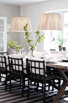 love everything about this dining room.... shaded pendants, chairs, table, striped rug & place settings