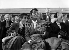 Dino & Jerry: Dean Martin (born Dino Paul Crocetti 1917 - 1995), the Hollywood film star with Jerry Lewis at White City during the World Middleweight Championship of 1953. (© Topical Press Agency/Stringer)