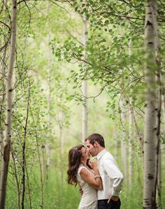 Love love love this picture of the couple in the trees... the photographer is far enough away that it makes the moment intimate and special