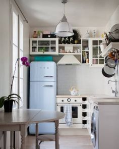 """10 Things We Wish We Had in Our Kitchens for this Thanksgiving (this photo, Smeg fridge in """"Parisian kitchen"""" Small Apartment Kitchen, Rental Kitchen, Small Space Kitchen, New Kitchen, Small Spaces, French Kitchen, Kitchen Sink, Apartment Interior, Apartment Design"""