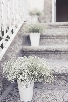Have a stairway leading to your front door? This is the perfect exterior touch! Babys breath in white vases by Andre Teixeira of Brancoprata Photography, Portugal! #Exteriors #Flowers
