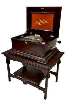 Stella rosewood music box, c. the hinged top opens to interior windup works, last patent date accompanied by 34 discs Music Boxes, Sound Of Music, Auction, Antiques, Interior, Top, Antiquities, Antique, Indoor