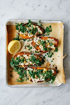 Roasted sweet potato with chick peas, goat cheese and coriander.
