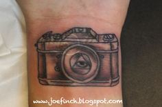 camera tattoo but with cross inside not illuminati