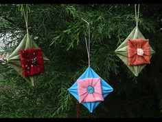 Fabric Folded Star Ornament │ This elegant little ornament looks deceivingly complicated but is oh, so easy to make. Start cutting up a wide variety of fabric squares, because you'll be wanting to make a whole bunch of these ornaments!