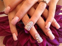 Acrylic nails with glitter dust and full Swarovski crystals on ring finger