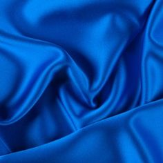 Mood's silk crepe-back satin is a medium-weight silk with a crepe face and a satin face. It has an exquisite drape and a lovely sheen, and makes sumptuous dresses, blouses, skirts and special occasion garments. Available in 96 attractive shades. Blue Fabric, Satin Fabric, Silk Satin, Princess Aesthetic, Blue Aesthetic, Mood Fabrics, Light Spring, Stretch Satin, Blue Satin